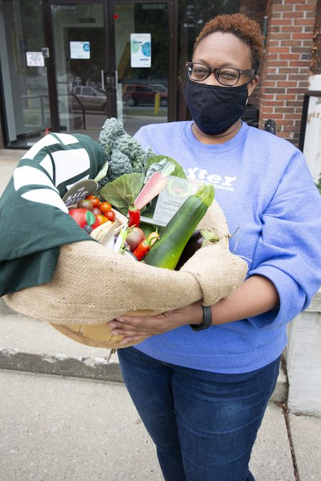 Sonja Forte, with Baxter Community Center, stands with the basket from Urban Roots